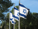 Three Israeli flags flying